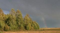 Autumn rainbow on farm fields Stock Footage