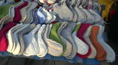 Many handmade knitted socks in street market Stock Footage