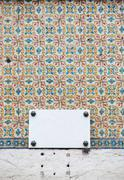 portuguese azulejos and marble sign - stock photo