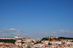 sao jorge castle and graça church - stock photo