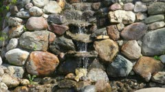Small falls flowing on stones Stock Footage