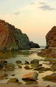 Water rock sunset Stock Photos