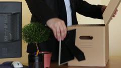 Downsized employee pack belongings - stock footage
