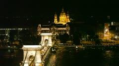 Budapest. Night view of chain Secheni Bridge and St. Stephane's basilica Stock Footage