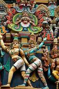 Stock Photo of kali image. sculptures on hindu temple gopura (tower). menakshi temple, madur