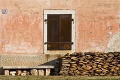 Stone bench, old window and logs - stock photo