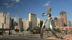 Time-lapse Zoom in to Dallas Skyline w/ public art and Dart trains Stock Footage