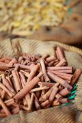 Stock Photo of big bag with cinnamon sticks in indian market