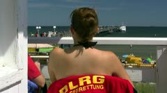 Young Woman on Lifeguard Tower on Rügen Island - Baltic Sea, Germany Stock Footage