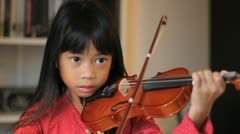 Intense 6 year Old Asian Girl Plays Her Violin Stock Footage