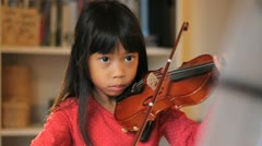 Six Year Old Asian Girl Practices Her Violin Stock Footage
