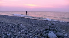 Angler in Beautiful Sunset - Baltic Sea, Northern Germany Stock Footage