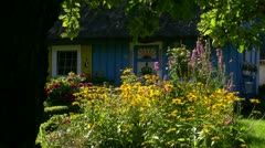 Old Thatched-Roof House with Beautiful Garden - Baltic Sea, Northern Germany Stock Footage