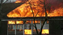 Fire and Orange Flames Destroy a Building During a Controlled Burn - Distruction Stock Footage