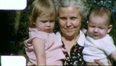 Loving Grandmother Holds Hugs Grandsons 1960s Vintage Film Home Movie 5660 Stock Footage