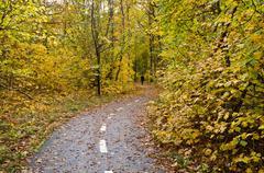 autumn walk at marked path - stock photo
