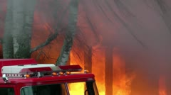 Fire engine in front of building on fire - orange flames Stock Footage