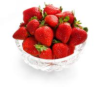 Strawberries in crystal bowl - stock photo