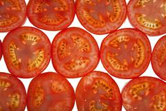 Sliced tomatoes background Stock Photos