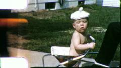 Infant Newborn BABY FUNNY HAT Closeup 1950s (Vintage Film Home Movie) 5668 Stock Footage