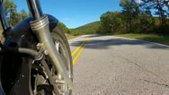 Stock Video Footage of Low Angle POV Motorcycle Riding Forest Road 1