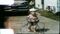 Infant NUTTY HAT BABY Walks in Driveway 1950s (Vintage Film Home Movie) 5669 Stock Footage