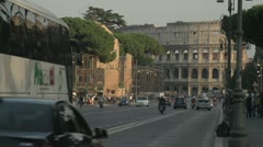 Rome traffic with coliseum in BG Stock Footage