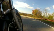 Stock Video Footage of Low Angle POV Motorcycle Riding Forest Road 3