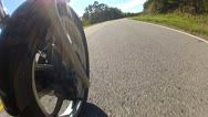 Stock Video Footage of Low Angle POV Motorcycle Riding Forest Road 4
