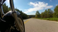 Stock Video Footage of Low Angle POV Motorcycle Riding Forest Road 5