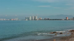 Puerto Vallarta across Banderas Bay beach surf HD 3941 Stock Footage