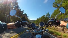 POV Motorcycle Riding On Forested Mountain Road Stock Footage