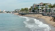 Puerto Vallarta Boardwalk Malecon across sand beach surf HD 3952 Stock Footage
