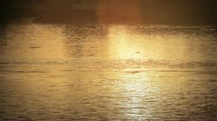 The sunset sky reflection on the river surface Stock Footage