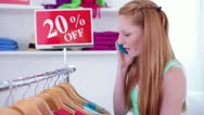 Teen/Tween Talking on Cell Phone While Clothes Shopping Stock Footage