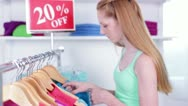 Teen/Tween Excited to Find an Item of Clothes at Discounted Price Stock Footage