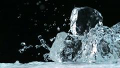 Water splashing against ice cubes, Slow Motion Stock Footage