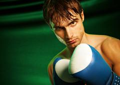 Man sweating all over in boxing gloves Stock Photos