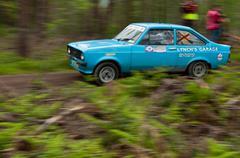 l. lynch driving ford escort - stock photo