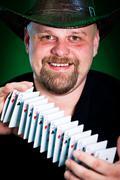 man skilfully shuffles playing cards - stock photo