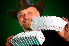 Man skilfully shuffles playing cards Stock Photos