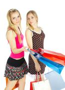 Two girls with bags - comparison shopping. sale! Stock Photos