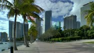Stock Video Footage of Miami downtown skyline along seen along river walk in early morning