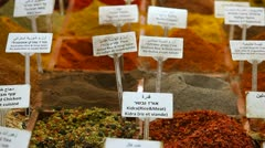 Spices and seasonings with names in English Hebrew and Arabic Stock Footage