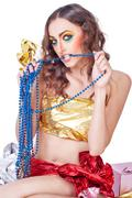 woman model with bright make-up and beads - stock photo