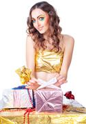 happy woman with bright make-up making gift - stock photo