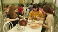Stock Video Footage of Children's Hospital Dining Room. Three girls are eating.