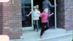 YEAH RECESS! Children Leave School 1960s (Vintage Retro Home Movie Film) 5693 - stock footage
