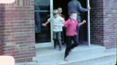 YEAH RECESS! Children Leave School 1960s (Vintage Retro Home Movie Film) 5693 Stock Footage