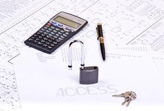 open padlock, pen, calculator and inscription access - stock photo